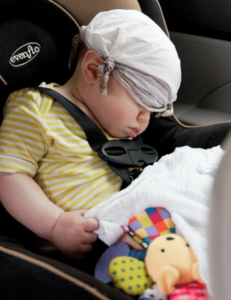 baby asleep in a safe space in the car