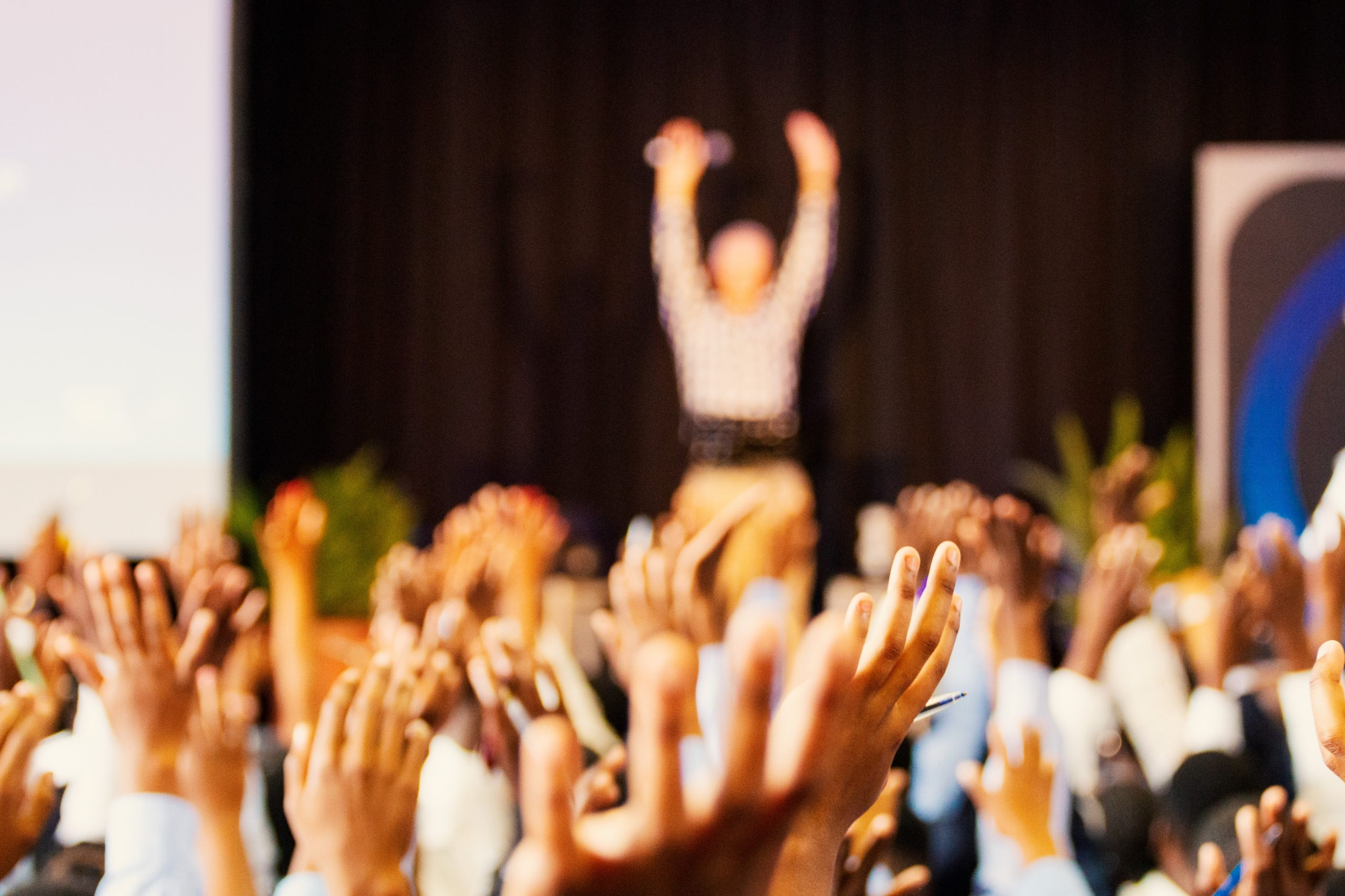 People putting their hands up in a facilitated workshop